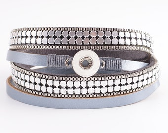 Mini snap charm bracelet. Double wrap leather bracelet with a magnetic closure is 15.7 inches long.
