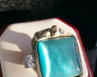 Sterling Silver Ring with light blue moonstone, lots of color with beading at end