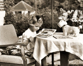Girl reading book in cafe. Germany, 1950th