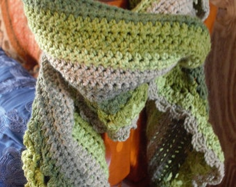 Handmade versatile scarf. Opens up to be a full sized shawl. Can be made in any available yarn and color combinations