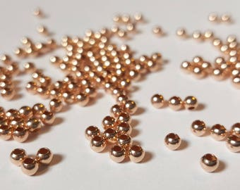 Pack of 50, vermeil 22k rose gold plated 925 sterling silver seamless 2.5mm round bead / spacer, 1.2mm hole [our ref: 11-1078]