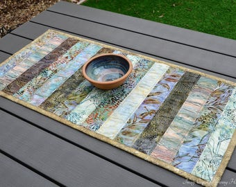 Batik table runner in muted earth & autumn tones of brown and green. Brown quilted patchwork table runner with batik fabric. Earthy decor UK