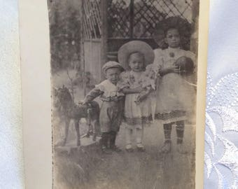 Old photograph, photog of pre-revolutionary period of 1910, Portrait of little girl Story of girl in photos, Retro style photo Vintage style