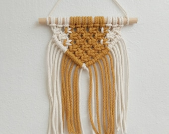 Mini macrame wall hanging in mustard yellow and white