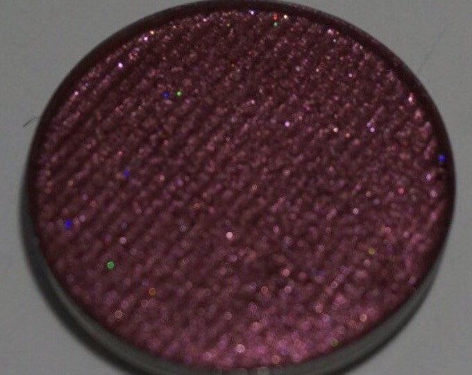 Bite the Apple eyeshadow - Bright, Metallic, Candy Apple Red with warm undertones and fine shimmery reflects