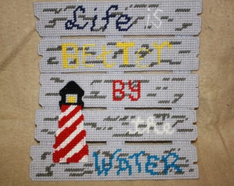 Life is better by the water fence wall hanging