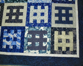 "Blue and white ""Gates of Serenity"" lap quilt"