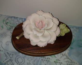 Porcelain Camillia flower on wooden base