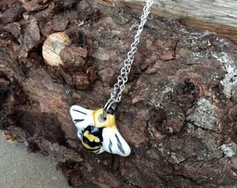 Handmade ceramic bee pendant.