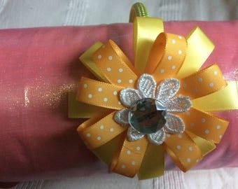 Yellow Handmade flower on lime green woven headband.