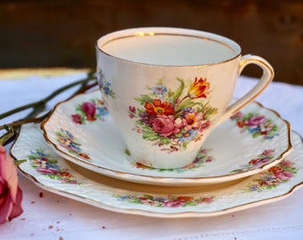 Fine Bone English china Tea Trio by EMPIRE ENGLAND 1950's.  Pretty floral design. Vintage Shabby Chic. Tea Party.