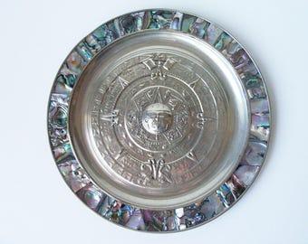 "Abalone shell on brass Maya calendar 7"" plate. Made in Mexico (#EV218)"