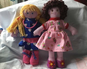 Dolls of fabric with dress or skirt and blouse, boots or shoes.