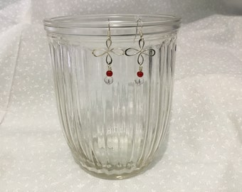 Sterling silver dangle earrings with red and clear glass beads.