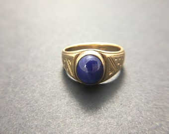 14K yellow gold with blue star sapphire