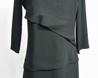 Black dress with ruffles trimmed