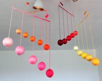 Montessori Gobbi mobiles warm colors