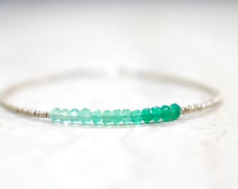 shaded green onyx seed beaded bracelet. thin seed bead gemmy string bracelet. shaded green onyx jewelry. green and chrome seed beads