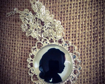 Silhouette cameo locket and paper silhouette.