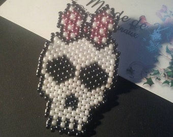Women's skull brooch
