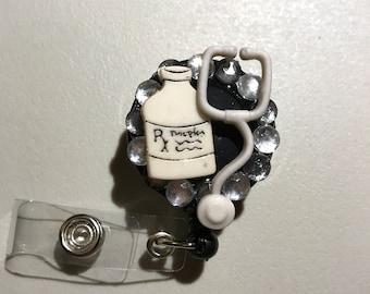 Medical retractable badge reel holder
