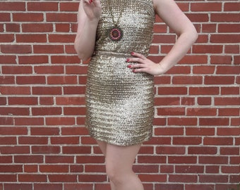 1960 vintage gold sequin mini for women. good condition
