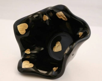 Black tealight holder, with gold hearts. Could be used for change, rings, bits n bobs.