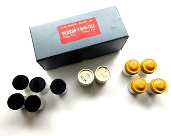 Collection of Vintage Kodak Film Canisters with Mid Century Camera Equipment Storage Box