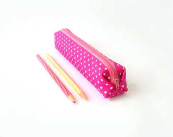 Small pencil case/zipper pouch in bright magenta with white dots and a pink zip