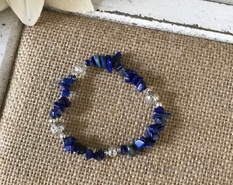Blue Lapis chip beads with silver accents.  Stretchy elastic, fits most.  Other bracelets pictured are sold separately.