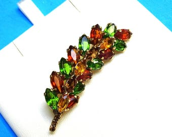 Leaf brooch. Rhinestone leaf brooch. Lovely prong set marquis stones set into gold tone open backing. Fall colors