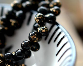 Beauty Queen - Premium Czech Glass Beads, Opaque Jet Black, Metallic Gold, Teardrops 5x7mm - Pc 25