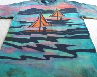 Sail boats, sunsets, palm trees, an island, man's large discharged and dyed t-shirt, procion dyes, turquoise, orange ,greens, red, pink