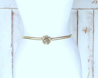 Vintage Ann Klein lions head skinny gold stretch metal snake style statement belt/gold hook belt/animal/cat/safari belt