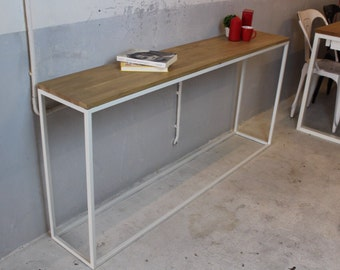 Solid oak with tubular white lacquered steel console.