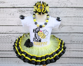 Girls Black and Yellow Bumble Bee Themed Appliqué Shirt and Ribbon Tutu Outfit with Matching Stacked Boutique Bow and Chunky Necklace.