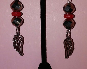Glass bead earrings with feather dangles.