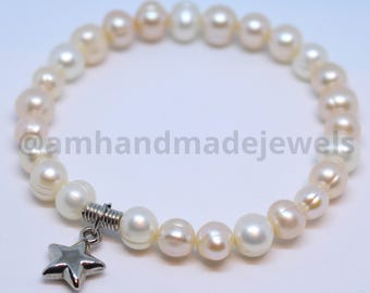 Bracelet of pearl with white metal pendant. Women and girls bracelet. A symbol of eternal love and joyful life.