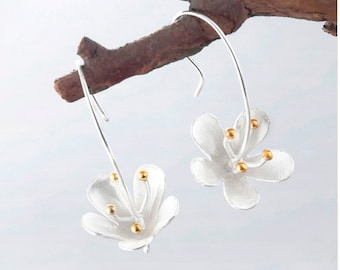 silver plated punched flowers and gold earrings