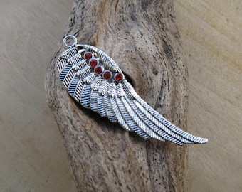 52x17x2mm red rhinestones and silver metal wing pendant.