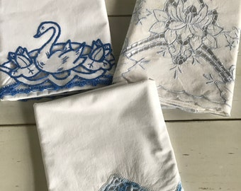 Lot of 3 vintage embroidered,crocheted pillowcases in blue. Cutters?