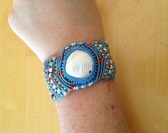 Blue, green, and orange micromacreame bracelet with white shell