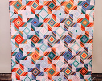 """Hand Quilted 60"""" by 70 """" geometric tesselating pinwheel lap quilt or wall hanging"""