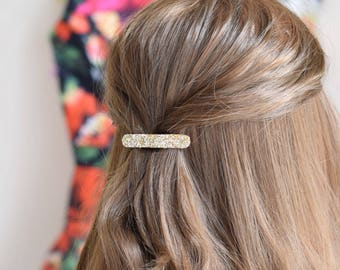Minimal gold glittery hair clip for special occasions