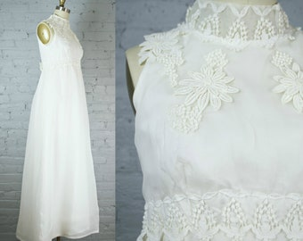 off white bohemian lace and chiffon vintage wedding gown . 1960s retro wedding dress by William Cahill . sleeveless and high neck . small