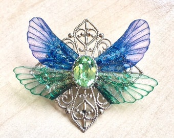 Blue and green brooch with fairy wings, transparent butterfly wings and green Swarovski crystal