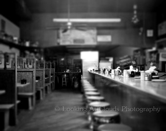 empty diner after hours art photo, vintage restaurant, diner counter, closed, black and white kitchen decor
