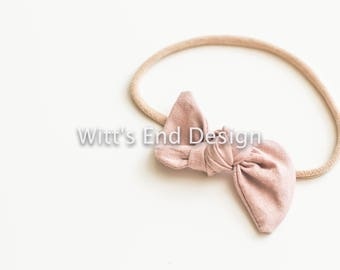 One Size Fits All- Top Knot Elastic Headband/Bow Collection- Blush on nylon or metal clip