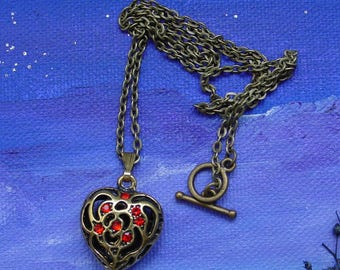 Chain bronze heart pendant and Red rhinestones