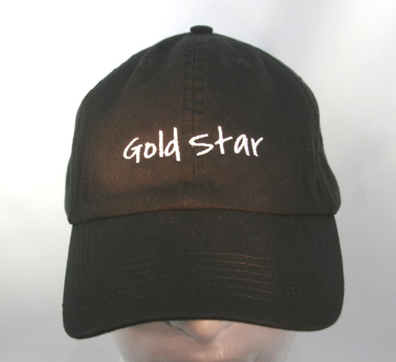 Gold Star (Polo Style Ball Black with White Stitching)